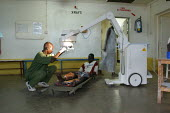 A South Sudanese war wounded is being checked with X-rays by a doctor at the Red Cross Lopiding Hospital, Lokichokio, Northern Kenya, December 2003. The legendary hospital was the main medical facilit... - Boris Heger - 03-12-2003