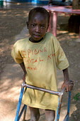 A South Sudanese war wounded boy learns back to walk in the Red Cross Lopiding Hospital, Lokichokio, Northern Kenya, December 2003. The hospital was the main medical facility for people in South Sudan... - Boris Heger - 03-12-2003