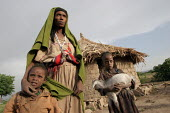 Zene Gemecho, a widow who live with her grandchlidren whose only possession is a goat, stands in front of her hut, Arebagosa, June 2006. The area is extremely dry and local people are starving. - Boris Heger - 07-06-2006