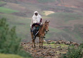 A farmer rides his horse, South Wollo region, Ethiopia, August 2005. The region is very poor and remote - Boris Heger - 08-09-2006