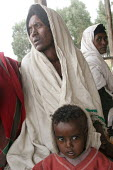 Woman and boy waiting for their turn at a medical facility, South Wollo region, Ethiopia, August 2005. The region is very poor and remote - Boris Heger - 08-09-2006
