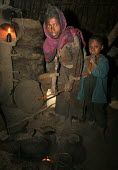 Villagers prepare some food, South Wollo region, Ethiopia, August 2005. The region is very poor and remote - Boris Heger - 08-09-2006