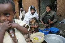 Fallashas Naney Tesfahun, 24, L, and Lemelem Feyesa, 14, R, wash dishes in front of their house while Ethiopian neighbours look on, in Addis Ababa, Ethiopia, 2005. Falashas Mura are jewish ethiopians... - Boris Heger - 04-02-2005