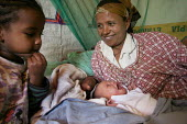 Mother on her bed and newly born daughter, Debre Zeit, Ethiopia, December 2005. - Boris Heger - 08-09-2006