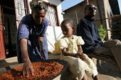 A family prepares to dry chili in front of their house, Debre Zeit, Ethiopia, December 2005. - Boris Heger - 08-09-2006