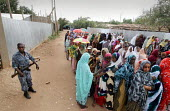 Muslim women wait to cast their vote as a policeman watches on, outside of a polling station in the regional capital city of Jijiga, Ethiopia, on Sunday, August 21, 2005. 1.5 million electors are due... - Boris Heger - ,2000s,2005,47,adult,adults,african,africans,AK,AK 47,AK47,AK47S,armed,Armed Forces,ballot,BALLOTING,ballots,capital,CLJ,democracy,dress,East Africa,election,elections,ethiopia,ethiopian,ethiopians,FE
