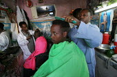 A boy has his hair cut in Gursom, in the Somali part of Ethiopia, February 2006. - Boris Heger - 02-02-2006