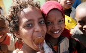 Children eating sweets in the streets of Gursom, in the Somali part of Ethiopia, February 2006. - Boris Heger - 02-02-2006