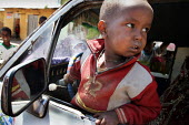 A boy looking out from a car on the streets of Gursom, in the Somali part of Ethiopia, February 2006. - Boris Heger - 02-02-2006