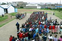Pupils line up and prepare to sing ahead of the start of the lessons, Mukuru school, Nairobi, Kenya, May 2004. - Boris Heger - 11-05-2004