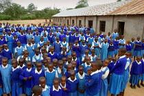Pupils line up ahead of the start of the lessons, Kajiado school, Machakos rural area, Kenya, May 2004. - Boris Heger - 11-05-2004