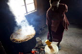 A lady prepares some porridge, Kajiado school, Machakos rural area, Kenya, May 2004. - Boris Heger - 2000s,2004,Africa,africans,BREAK,cauldron,cook,COOKERY,cooking,cooks,corn,daily,DINNER,dinners,DINNERTIME,EQUALITY,excluded,exclusion,feeding,FEMALE,Food Aid,HARDSHIP,hunger,hungry,impoverished,impove