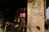 A girl recently returned from refugee camps in Guinea just resettled in her former family house destroyed during the war which bears the inscription War is not good, near Kolahun, near the border with... - Boris Heger - ,2000s,2006,Africa,african,africans,bears,border,camp,camps,communities,community,conflicts,DDR,demobilisation,demobilization,Diaspora,disarmament,displaced,EQUALITY,excluded,exclusion,families,family