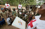 Members of the Nigerian Red Cross talk to mothers in a village near Katsina, Nigeria 2006, about pregnancy, hygiene, AIDS and bird flu problems. - Boris Heger - 04-03-2006