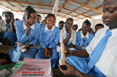 Pupils learn how to use a condom during a school workshop conducted by the Nigerian Red Cross about AIDS problems in Katsina, Nigeria 2006. - Boris Heger - 2000s,2006,Acquired immune,agencies,agency,aid,aid agency,aid workers,AIDS,charities,charity,child,CHILDHOOD,children,con,condom,condoms,contraception,contraceptive,contraceptives,deficiency syndrome,