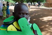 Local Dinka child selling shoes, Yei, South Sudan, April 2004 - Boris Heger - 01-05-2004