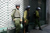 Policemen stand guard in front of the National Mining Corporation, ahead of possible riots about nationalisation of the industry, La Paz, Bolivia, August 2004 - Boris Heger - 2000s,2006,adult,adults,americas,Amerindian,Amerindians,bolivia,Bolivian,Bolivians,capitalism,capitalist,cities,city,CLJ,force,guard,Industries,industry,Latin America,maker,makers,making,male,man,MATU