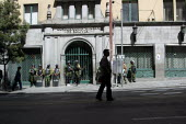 Policemen stand guard in front of the National Mining Corporation, ahead of possible riots about nationalisation of the industry, La Paz, Bolivia, August 2004 - Boris Heger - 2000s,2006,adult,adults,americas,Amerindian,Amerindians,bolivia,Bolivian,Bolivians,capitalism,capitalist,cities,city,CLJ,force,guard,Industries,industry,Latin America,maker,makers,making,MATURE,MINE,M