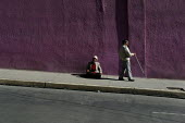 A blind person passes in front of a beggar, in the citys center, La Paz, Bolivia, August 2004 - Boris Heger - 2000s,2006,americas,Amerindian,Amerindians,baggar,beg,beggar,beggars,BEGGER,begging,begs,bolivia,Bolivian,Bolivians,cities,city,disabilities,disability,disable,disabled,disablement,EQUALITY,excluded,e