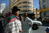 Indigenous people in the citys center, La Paz, Bolivia, August 2004 - Boris Heger - 2000s,2006,americas,Amerindian,Amerindians,bolivia,Bolivian,bolivians,Bowler Hat,cities,city,EBF Economy,FEMALE,hats,indigenous,Latin America,pedestrian,pedestrians,people,person,persons,Pollera,scene