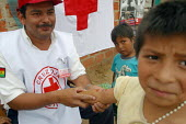 Children are being vaccinated by a Bolivian Red Cross volunteer in a slum nicknamed Vietnam by locals in reference to its poor infrastructure, Santa Cruz, Bolivia, August 2004 - Boris Heger - 29-08-2006