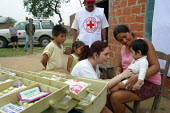 """Children are being vaccinated by a Bolivian Red Cross volunteer in a slum nicknamed """"Vietnam"""" by locals in reference to its poor infrastructure, Santa Cruz, Bolivia, August 2004 - Boris Heger - 29-08-2006"""