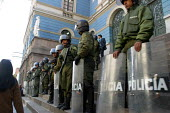 Policemen stand guard in front of a bank ahead of possible riots about nationalisation of gas industry, La Paz, Bolivia, August 2004 - Boris Heger - ,2000s,2006,adult,adults,americas,Amerindian,Amerindians,bank,BANKS,bolivia,Bolivian,Bolivians,capitalism,capitalist,cities,city,CLJ,force,guard,Industries,industry,Latin America,maker,makers,making,M