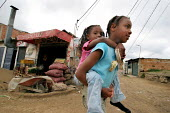 Displaced children play in the streets in Los Altos de Cazuca, one of the worst slums in Bogota, Colombia, January 2006. There are an estimated 3 million people displaced by conflict with guerrilla gr... - Boris Heger - 30-08-2006