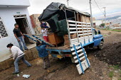A newly arrived displaced family get settled in Los Altos de Cazuca, one of the worst slums in the Bogota, Colombia, January 2006. There are an estimated 3 million people displaced by conflict with gu... - Boris Heger - 30-08-2006