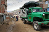 An old vehicle pass in the streets of Los Altos de Cazuca, one of the worst slums in Bogota, Colombia, January 2006. There are an estimated 3 million people displaced by conflict with guerrilla groups... - Boris Heger - 30-08-2006