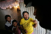 A displaced woman talks with a visitor in her shelter, in Los Altos de Cazuca, one of the worst slums in Bogota, Colombia, January 2006. There are an estimated 3 million people displaced by conflict w... - Boris Heger - 2000s,2006,adult,adults,americas,amerindian,amerindians,anger,angry,armed,barrio,barrios,Bogota,child,CHILDHOOD,children,colombia,Colombian,Colombians,conflict,daughter,DAUGHTERS,displaced,displacemen