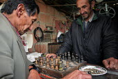 Two men play chess, in Los Altos de Cazuca, one of the worst slums in Bogota, Colombia, January 2006. There are an estimated 3 million people displaced by conflict with guerrilla groups. - Boris Heger - 30-08-2006