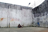 Lone detainee eating a meal, Quibdo, Colombia, August 2004. - Boris Heger - 30-08-2006