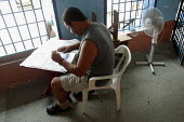 A detainee reading a newspaper at the central jail, Quibdo, Colombia, August 2004. - Boris Heger - 30-08-2006