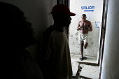 Detainees in a corridor at the central jail, Quibdo, Colombia, August 2004. Salida ironically means exit. - Boris Heger - 30-08-2006