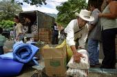 People displaced by conflict with guerilla groups receive assistance from the Red Cross, Cocorna, region of Medellin, Antioquia, Colombia, August 2004. - Boris Heger - 30-08-2006