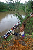 An internally displaced by FARC guerillas Embera girl stands by the pirogue transit point, near the Embera village of Boca de Pay, Darien region, Panama, August 2004. This region is very remote. - Boris Heger - ,2000s,2006,agencies,agency,aid,aid agency,americas,Amerindian,Amerindians,armed,BAME,BAMEs,BME,bmes,boat,boats,Boca de cupe,Cana,canoe,canoeing,canoes,charities,charity,Chico,child,CHILDHOOD,children