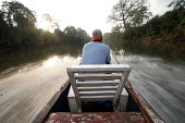 A man stands at the front of a pirogue, the only way to travel to Boca de Cupe, Darien region, Panama, January 2006. This remote region is only accessible by boat. - Boris Heger - 30-08-2006
