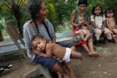 Internally displaced by FARC guerillas, an Embera indigenous family who used to live right on the border with Colombia, near Yaviza, Darien region, Panama, living in dire conditions in Arrevachi villa... - Boris Heger - 2000s,2006,adult,adults,americas,Amerindian,Amerindians,armed,BAME,BAMEs,BME,bmes,Boca de cupe,border,boy,boys,Cana,child,CHILDHOOD,children,Colombia,communities,community,country,countryside,Darién,