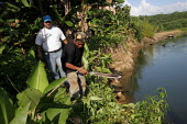 A UNHCR staff member follows a local man as he cuts a path through the dense jungle that lies between Arrevachi village and theRio Tuira river to visit Colombian refugees. This remote region is only a... - Boris Heger - 12-01-2006
