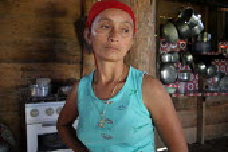 A colombian refugee woman in her house, Yape, Darien region, Panama, January 2006. This region is very remote. - Boris Heger - 2000s,2006,adult,adults,americas,amerindian,amerindians,Boca de cupe,by,Cana,Civil War,colombian,communities,community,country,countryside,Darién,Darien Gap,Diaspora,displaced,EQUALITY,excluded,exclu