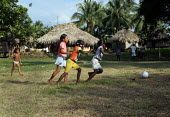 Colombian refugees displaced by the civil war in their country play football with local children, Boca de Cupe, Darien region, Panama, January 2006. This region is very remote. - Boris Heger - 30-08-2006