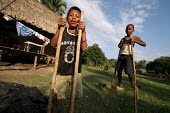 Colombian refugees displaced by the civil war in their country and local children play together walking on stilts, a traditional game in the region, Boca de Cupe, Darien region, Panama, January 2006.... - Boris Heger - 30-08-2006