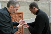 Two detainees who have tuberculosis light a candel before praying for their health, at the central prisons hospital, Yerevan, Armenia, February 2005. Tuberculosis is a disease that is widespread in ja... - Boris Heger - 2000s,2005,Armenia,armenian,armenians,asian,Caucasus,christian,Christianity,christians,clJ crime law justice,detainee,detainees,disease,diseases,hea health,health,hospital,HOSPITALS,imprisonment,incar