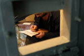 A detainee sentenced to life writes a letter to relatives, central prison,Yerevan, Armenia, February 2005. - Boris Heger - 28-02-2005
