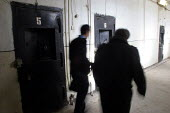 Lawyers pass in front of detainees cells in the central prison of Goris, Armenia, February 2005. - Boris Heger - 02-03-2005