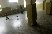 A lone woman plays football with her child in the woman and minors prison of Abovian, Erevan, Armenia, February 2005. - Boris Heger - 28-02-2005