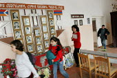 Children passing in front of portraits of war heroes displayed in their classroom, at the elementary school, Khnatzakh, Nagorno Karabakh, Azerbaidjan, March 2005. The region, although officially locat... - Boris Heger - 03-03-2005