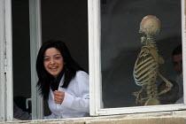 A medical student watches through the window at the Artsakh State University, Stepanakert, Nagorno Karabakh, Azerbaidjan, March 2005. - Boris Heger - 03-03-2005