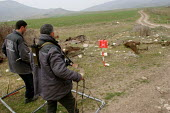 Deminers from the non-governmental organization Halo Trust - The Hazardous Areas Life-Support Organisation - are at work along the old front line, 500 metres from the local school. Entire fields are s... - Boris Heger - 03-03-2005